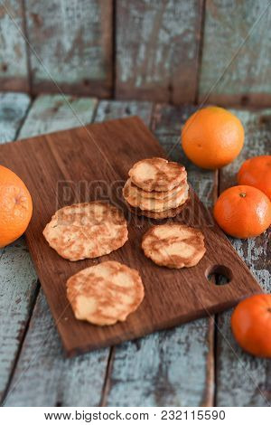 Vegetarian Sweets. Homemade Thin Cookies With Raw Oranges And Clementines On Shabby Blue Wooden Back