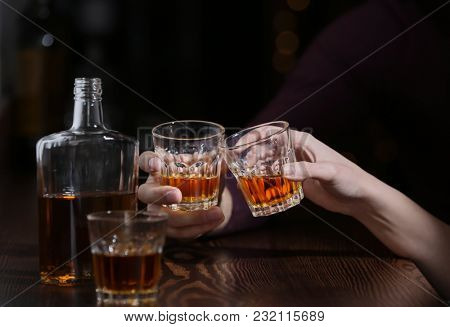 Couple drinking in bar, closeup. Alcoholism problem