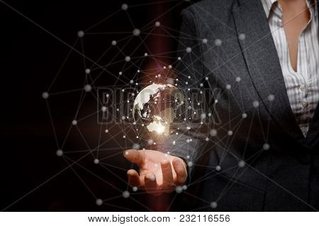 Network In Businesswoman Hand Over Dark Background.
