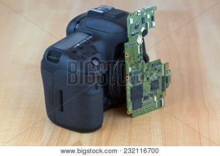 Motherboard Main board for Digital camera replacement, soft focus on wooden background