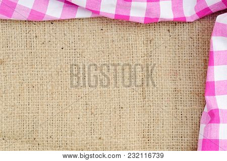 Purple Folded Checkered Rural Tablecloth Over Canvas Shaped Like Frame