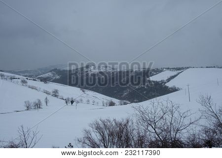 View Of A Rural Area Covered In Snow On The Apennine Mountains Near Bologna, Italy.