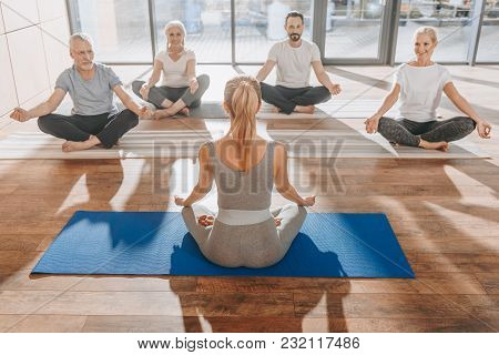 Group Of Women Meditating In Lotus Yoga Pose With Mudra Of Knowledge