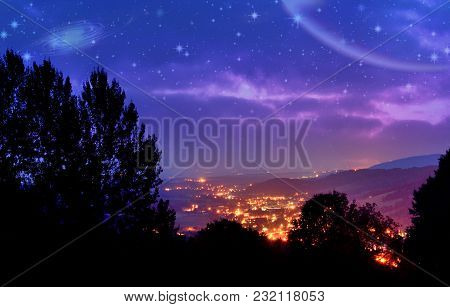 Magnificent View Of The Shining City In The Valley, And The Glow Of The Stars In The Night Sky
