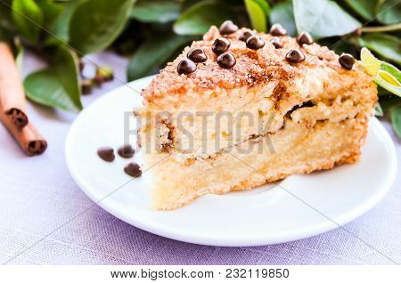 Piece Of Traditional American Coffee Cake With Brown Sugar, Cinnamon, Chocolate Chips Or Drops On A