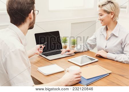 Young Casual Business Partners Work With Laptop In Modern Office, Copy Space On Screen
