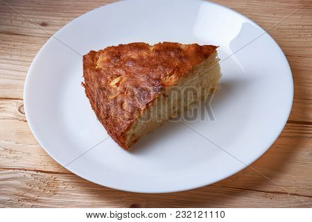 Tasty Apple Pie Slice On White Plate And Wooden Table