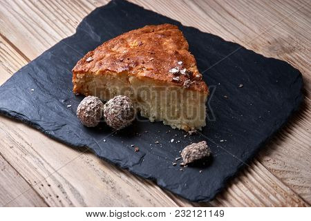 Apple Pie Tart On Shale Board With Raisins, Nuts And Cinnamon Is A Vintage Wooden Background Texture