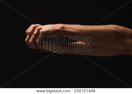 Clasped Male Hands On Black Isolated Studio Background, Low Key, Copy Space, Cutout