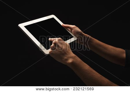 Male Hands Holding And Pointing To Blank Screen Of Digital Tablet. Caucasian Man Using Device With E