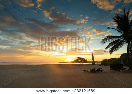 Colorful sunset over ocean on tropical island