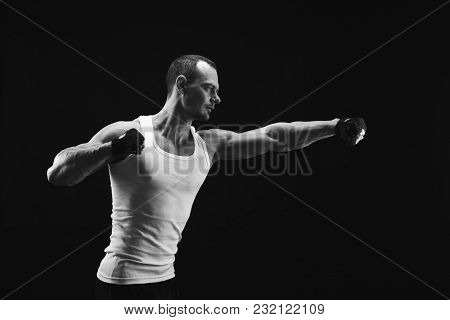 Athletic Man Make Punch. Handsome Fitness Model Show Muscular Body. Studio Shot, Black And White Ima