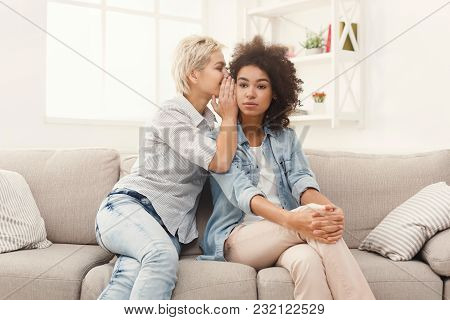 Young Woman Telling Her Girlfriend Some Shocked Secret. Two Women Gossiping. Excited Emotional Girl