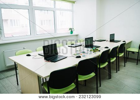 Interior Of Classroom With Laptops On Desk At Stem Education Courses