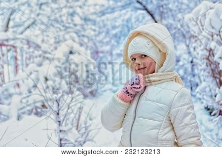 Portrait Of Adorable Little Girl Outdoors On Cold Winter Day