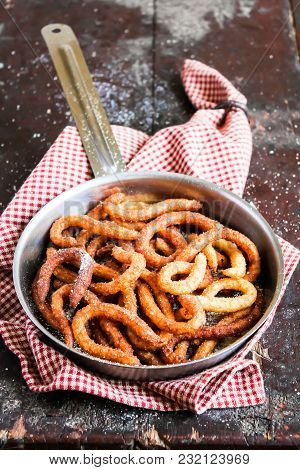 Cooking Pan With Traditional Spanish Dessert Churros With Chocolate Sauce On A Wooden Table, Selecti