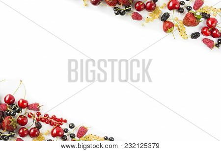 Mix Berries And Fruits At Border Of Image With Copy Space For Text. Ripe Cherries, Strawberries, Cur