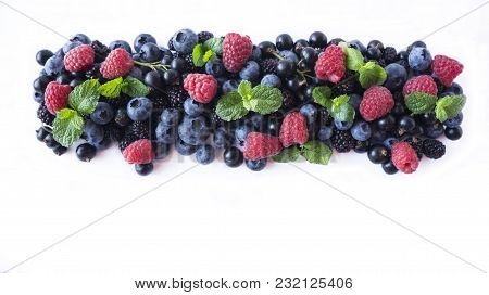 Ripe Currants, Blackberries, Blueberries And Raspberries With Mint Leaves. Mix Fruits And Berries Is
