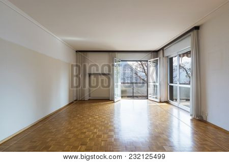 Flat living room to be restored with a view of the Ticino hills. Nobody inside