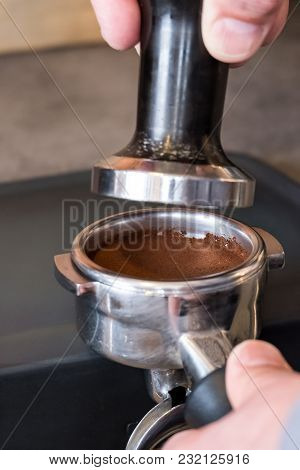Barista Placing Tamper Over Fresh Tamped Coffee In Portafilter To Making Espresso Or Cappuccino