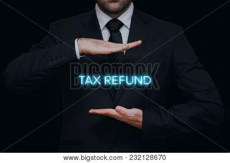 Tax Refund Concept. Businessman Showing Lighten Tax Refund Between His Hands.