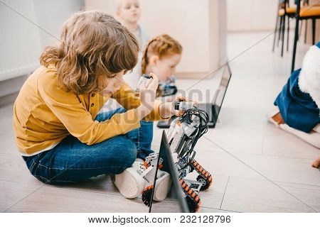 Kids Sitting On Floor At Machinery Class, Stem Education Concept