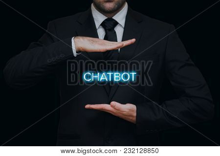 Businessman With Chatbot Text Between His Hands