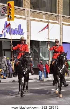 OTTAWA, CANADA - Mar. 10, 2012: RCMP riding in Saint Patrick's Day Parade in Ottawa, Canada.