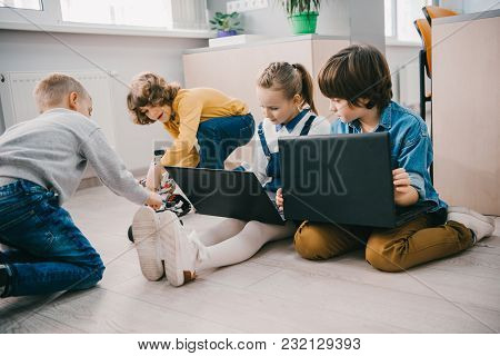 Happy Kids Working With Laptops On Floor, Stem Education Concept