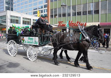 OTTAWA, CANADA - MAR. 10, 2012: Horse drawn carriage in Saint Patrick's Day Parade in Ottawa, Ontario, Canada.