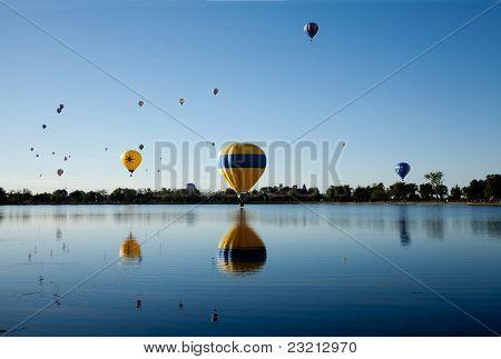 Hot air balloons and lake