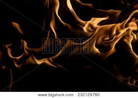 Daemon Face Looking From The Depths Of Fire
