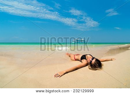 woman resting at the  tropical beach