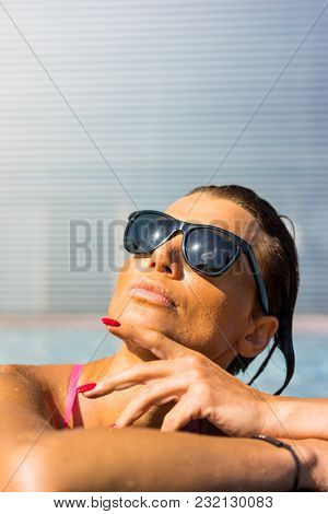 Woman enjoying relaxation at the pool