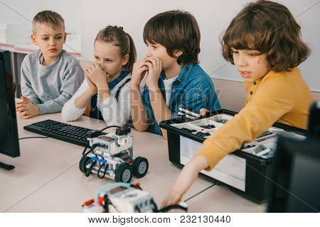 Little Kids Constructing Robots At Stem Education Class