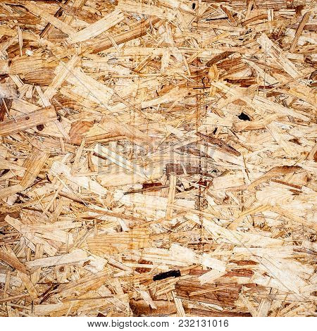 Wooden Panel Background Texture. Pressed Osb Wooden Panel Texture. Oriented Strand Board.