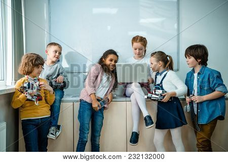 Group Of Kids With Laptop And Robots On Stem Education Class