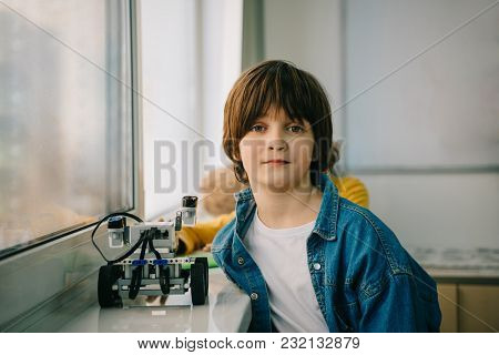 Little Kid With Diy Robot At Stem Education Class