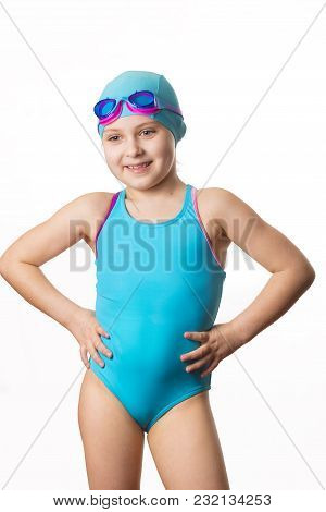 Swimmer: Little 7 Years Old Cute Caucasian Girl In Cyan Swimming Costume . Isolated On White Backgro