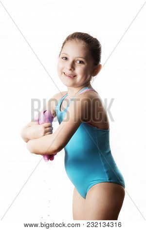 Swimmer: Little 7 Years Old Cute Caucasian Girlie In Cyan Swimming Costume Twistting A Pink Shammy,