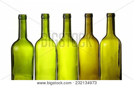 Close Up Group Of Five Empty Washed Green Glass Wine Bottles In A Row Isolated On White Background,