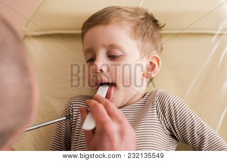 Medical Checkup Of Kid With Mother In Clinic. Pediatrician Listen Little Boy With Stethoscope.