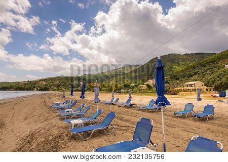 Sunbeds And Umbrellas On Kalamaki Beach, Also Now As Apraos Beach Near Kassiopi On Corfu Island. Gre