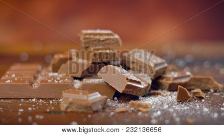 Sweet And Salty Chocolate Snacks, Salted Caramel Bar, Macro Close Up On Rustic Wood Background.