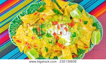 Cinco De Mayo Party Table With Nachos Food Platter On A Red Wood Background.