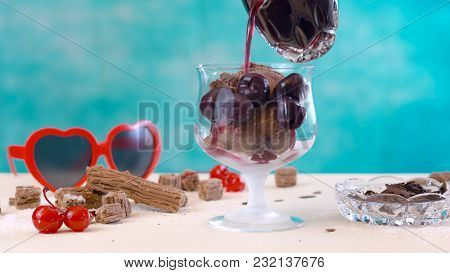 Making Summertime Gourmet Chocolate Cherry And Coconut Ice Cream Sundae, Pouring Sauce.