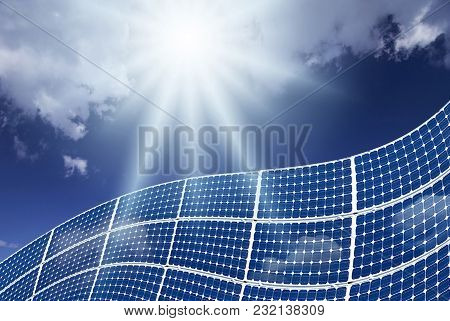 Picturesque Landscape With Blue Sky And Rays Of Sunshine Illuminating Solar Panels