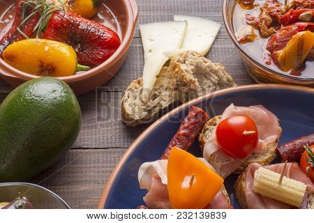 Sharing Mixed Spanish Tapas Food Starters On Old Vintage Table. Top View.