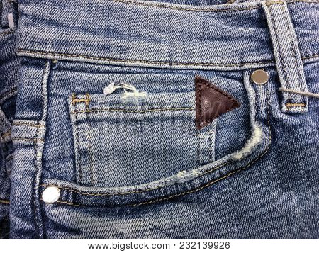 Denim jeans texture background with old torn. Stitched texture denim jeans background of fashion jeans design. Jeans rivet