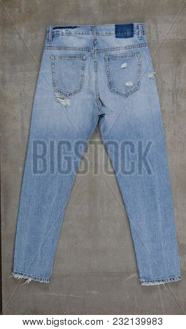 Back of blue jeans isolated on gray background